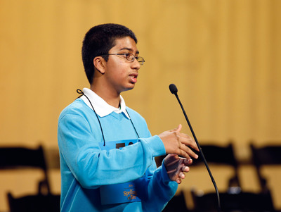 Syamantak Payra prepares to spell a word in the final round of the Houston Public Media Spelling Bee declaring him and Shobha Dasari co-champions.