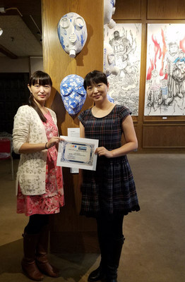 Artist twins from China, Beibei and Leilei Chen, displaing their 2016 Special Recognition prize from this year's ArtPrize event, which they won for their piece Gas Masks.