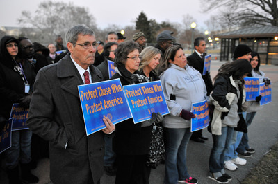Don and Jean Williams (foreground), parents of slain Bureau of Prisons correctional officer Don Williams, attend a Feb. 11 vigil on Capitol Hill in Washington D.C., arranged by the American Federation of Government Employees, to honor federal prison officers killed in the line of duty.  (PRNewsFoto/American Federation of Government Employees)