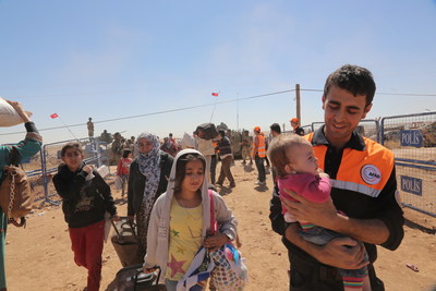 AFAD staff welcoming Syrian refugees in Suruc, Turkey