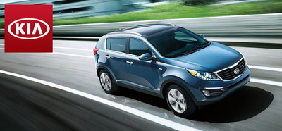 The 2014 Kia Sportage is powered by a four-cylinder engine which allows it to achieve superior fuel economy ratings.  (PRNewsFoto/Briggs Auto Group)