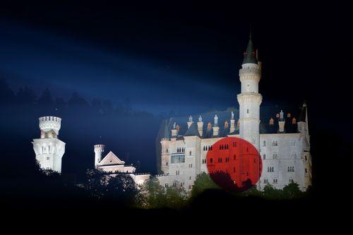 The Free State of Bavaria welcomes Japan to the G7 summit by illuminating Neuschwanstein Castle in Japanese colours. (PRNewsFoto/Bayerische Staatskanzlei)