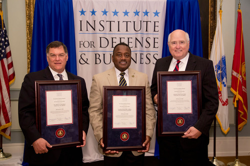 A few of the new IDB Executive Fellows holding their certificates at the Induction Ceremony at the Army and Navy Club on Oct 9, 2013. Vice Admiral W. Mark Skinner, USN (Ret.) former Principle Military Deputy to the Assistant Secretary of the Navy, Lieutenant General Willie J. Williams, USMC (Ret.) former Chief of the Marine Corps Staff and Lieutenant General Loren M. Reno, USAF (Ret.) former Deputy Chief of Staff for Logistics, Installations and Mission Support.  (PRNewsFoto/Institute for Defense and Business)