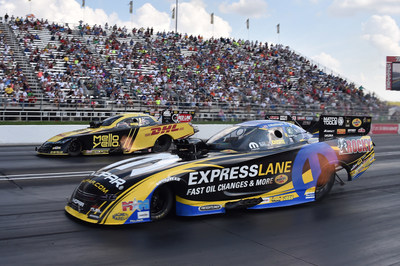 Matt Hagan, near lane, drove his Mopar Express Lane Dodge Charger R/T to the U.S. Nationals Funny Car win over Del Worsham.