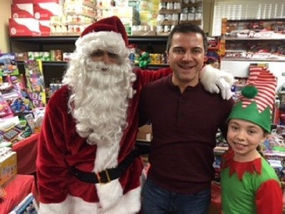 Anthony Merhan with Santa and his elf