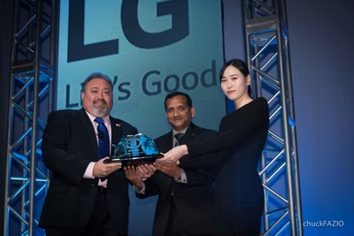 ISRI Chairman Doug Kramer (left) presents the 2015 Design for Recycling(R) Award to Dr. Nandhu Nandhakumar, senior vice president, LG Technology Center of America, and Jane Kang, head of product stewardship, LG Electronics USA.