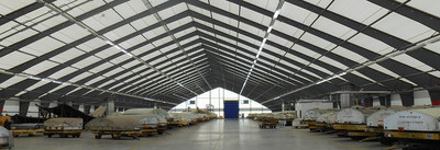 Spirit AeroSystems adds fabric storage facility by Legacy Building Solutions. Tension fabric structures (TFS) are suitable for military shelter systems; for general aircraft aviation hangars, vehicle maintenance, fuel cell storage, equipment storage, shade structures, and warehouse buildings. Galvanized rigid steel frames provide clear spans to over 300'. Liners, insulation systems, and hangar doors are available options. Watch a fabric building drone video at http://www.legacybuildingsolutions.com/fabric-building-video (PRNewsFoto/Legacy Building Solutions)