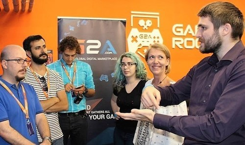 G2A's CMO and co-founder, Dawid Rozek, talking to journalists in the G2A gamesroom, responding to their ...