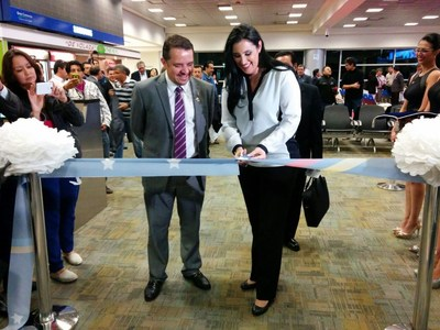 Minister of Transport and Public Works Paola Carvajal performed the ribbon cutting of TAME's inaugural flight from Fort Lauderdale to Quito.