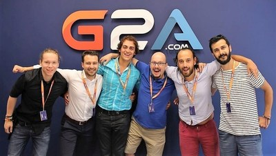 Some of the Journalists pose in the G2A meeting room (PRNewsFoto/G2A.COM)