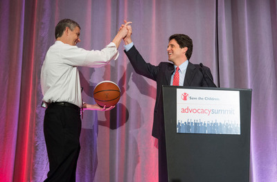 Save the Children's senior vice president Mark Shriver presented U.S. Secretary of Education Arne Duncan with a personalized #DunkinDuncan basketball, paying a tribute to the former professional ball player's days on the basketball court. Secretary Duncan spoke about the importance of early childhood education during Save the Children's Advocacy Summit on April 8, in Washington, D.C., in front of an audience of students from across the country. Photo by Joshua Roberts for Save the Children.