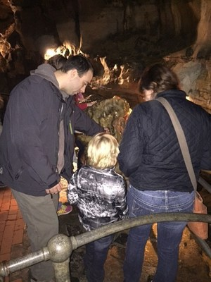 Wounded Warrior Project Alumni and their families inspect the rock formations of Howe Caverns during an Alumni program event.