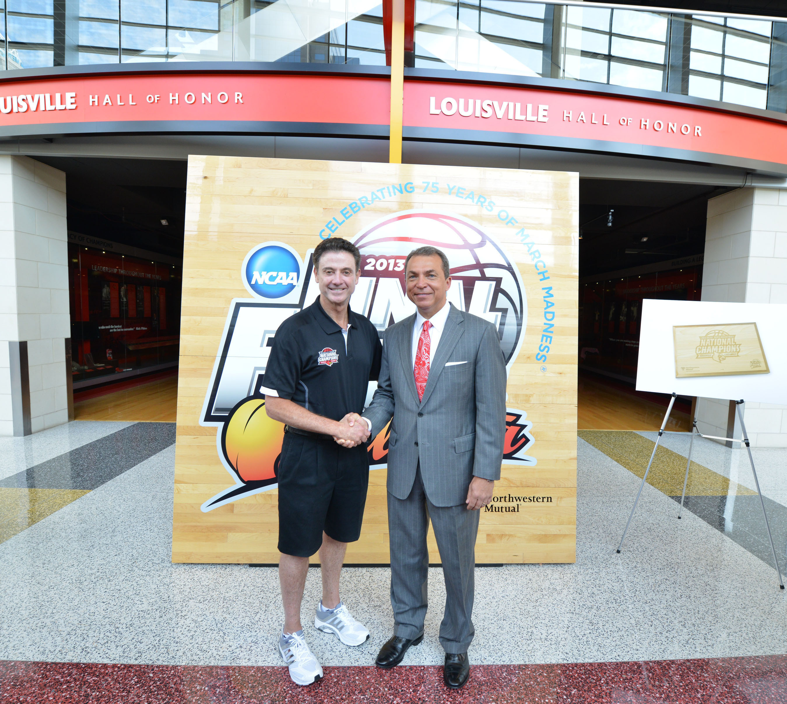 University of Louisville Head Coach Rick Pitino (left) stands in front of a replica of the 2013 NCAA Championship Floor with Northwestern Mutual's Dan Rivers (right).  (PRNewsFoto/Northwestern Mutual)
