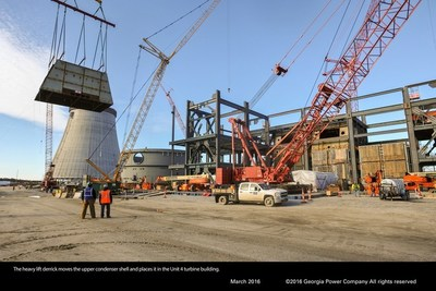 The heavy lift derrick moves the upper condenser shell and places it in the Unit 4 turbine building.