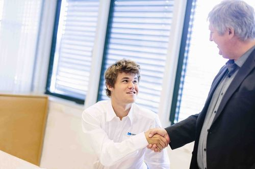 Magnus Carslen, the youngest ever chess world number 1, shakes hands on a three-year sponsorship deal with Nordic Semiconductor CEO Svenn-Tore Larsen (right)