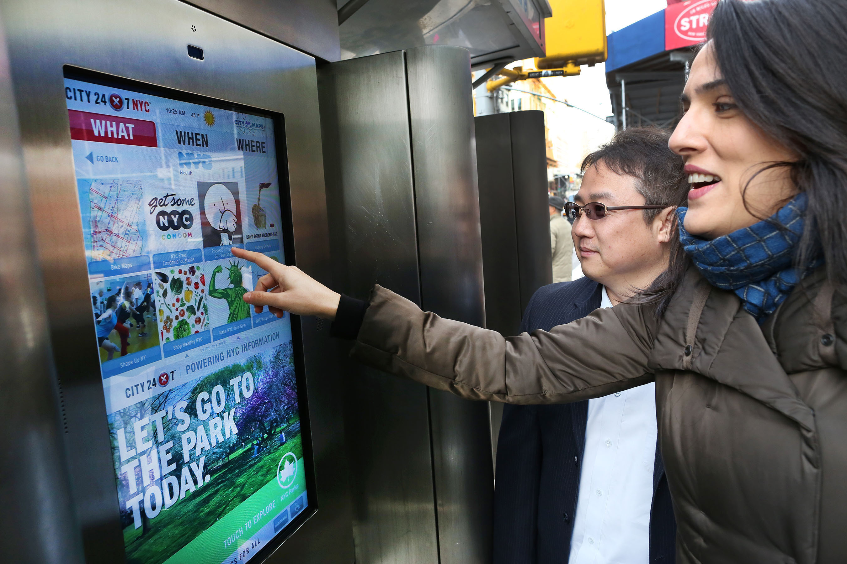 Jennifer Falk, Executive Director for The Union Square Partnership, and Jay Kang, Marketing Manager for LG Electronics USA Home Electronics B2B Division, interacting with an interactive touch-screen display unveiled today in the Union Square area of Manhattan. City24/7, the New York-based start-up that developed the pilot program with the City Department of Information Technology and Telecommunications, chose the 32-inch class LG Touch-Screen Monitor for its ruggedized outdoor design and high-definition touch capabilities.  (PRNewsFoto/LG Electronics USA)
