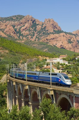 A TGV train whisks passengers through the French countryside. Get extensive travel on the national rail network of France with a France Rail Pass from RailEurope.com.