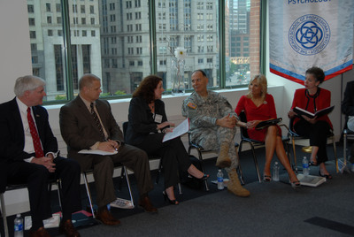 U.S. Army photo by Spc. Chasity Johnson, Illinois National Guard Public Affairs Office/Dr. Michele Nealon-Woods (third from left), president of The Chicago School of Professional Psychology, addresses attendees at a June 16 forum hosted at the school's Chicago Campus in collaboration with the Illinois National Guard. The event was a part of Dr. Jill Biden and First Lady Michelle Obama's Joining Forces Initiative to mobilize all sectors of society to provide support and opportunities to service members and their families.    (PRNewsFoto/The Chicago School of Professional Psychology)