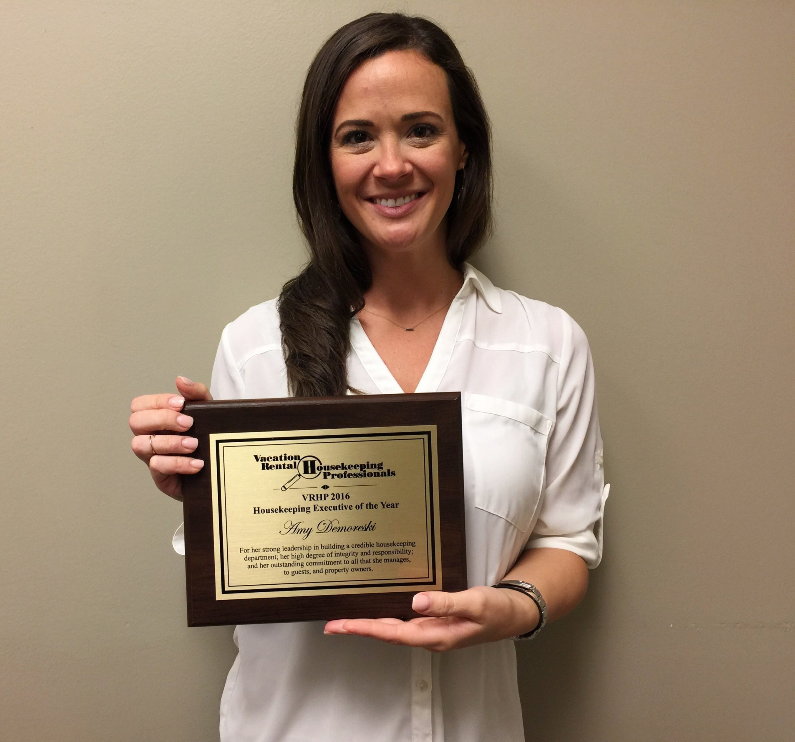 Amy Demoreski, Five Star Properties, Director of Housekeeping holds onto her award for VRHP's 2016 Executive Housekeeper of the Year.