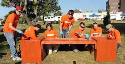 LOS ANGELES, CA - AUGUST 24:  Members of multi-platinum rock band 3 Doors Down including Greg Upchurch (L), Brad Arnold (4th from L), Chris Henderson (3rd from R), Matt Roberts (2nd from R), and Todd Harrell (R) join President of The Home Depot Foundation Kelly Caffarelli (3rd from L) and volunteer Keith Deutsch for The Home Depot Foundation Launches Celebration Of Service Campaign With 3 Doors Down To Honor Veterans on August 24, 2011 in Los Angeles, California.  (PRNewsFoto/The Home Depot Foundation)