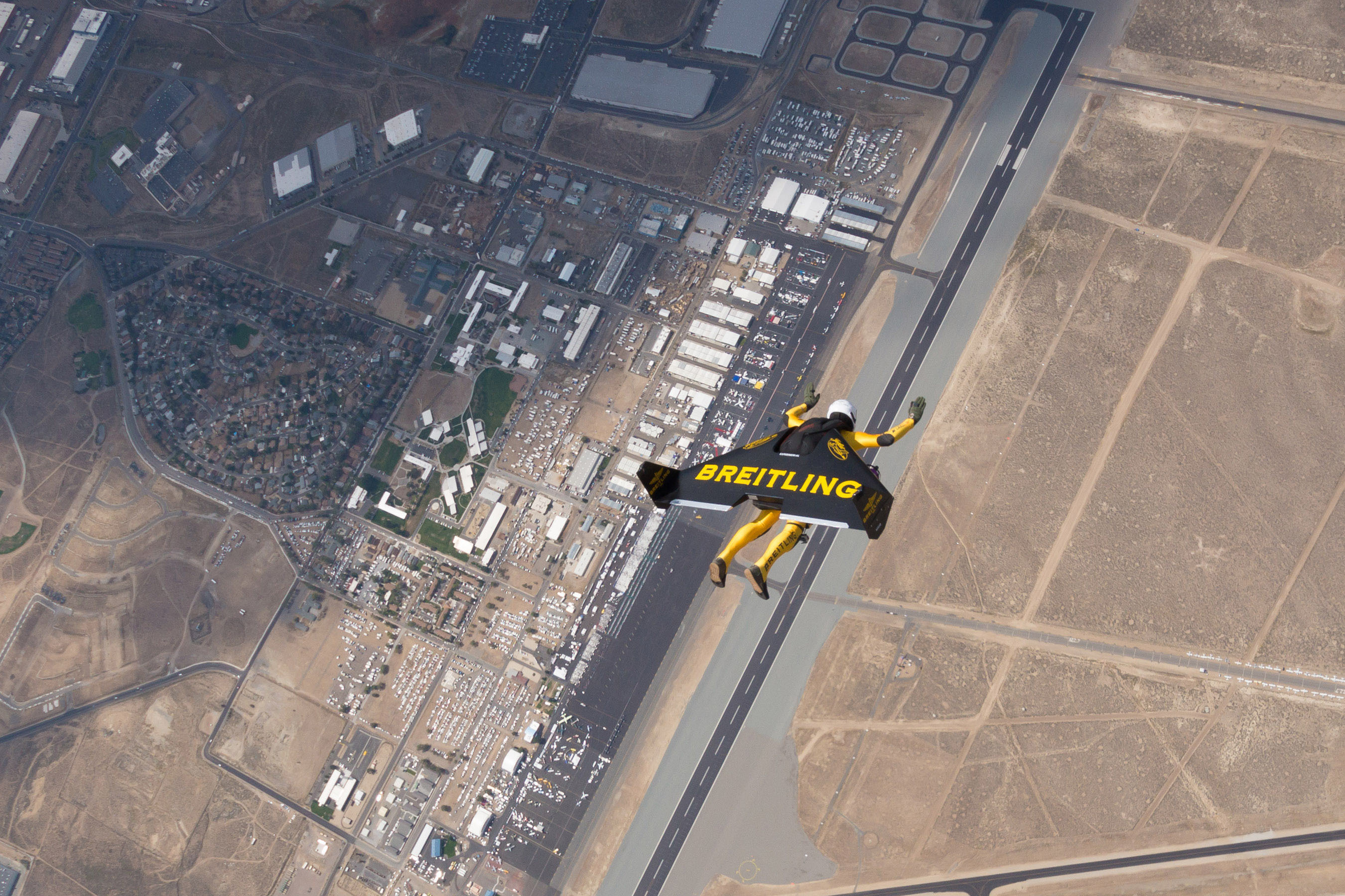 """Yves """"Jetman"""" Rossy performs during the National Championship Air Races in Reno, NV. Photo by Bernet, courtesy of Breitling SA. (PRNewsFoto/Breitling, Bernet) (PRNewsFoto/BREITLING)"""