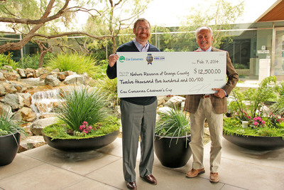Jared Rowe, president of Irvine-based company Kelley Blue Book (pictured left), donates funds to James Sulentich of the Nature Reserve of Orange County.  (PRNewsFoto/Kelley Blue Book)