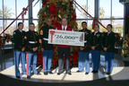 Wayne Harkley, MSgt, USMC (Retired) and local ROTC Cadets from the Fontana High School Marine Corps Junior Officers Training Corps received the check on behalf of the Marine Corps Reserve.  (PRNewsFoto/Stater Bros. Charities)