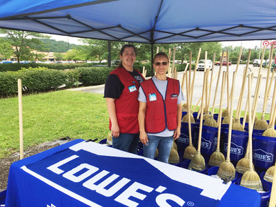 Volunteers from Lowe's stores in East Charleston and South Charleston passed out free cleanup kits Tuesday at community relief events.