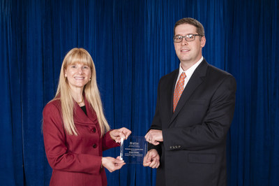 Dr. Maureen Hunter, president of the Society of Tribologists and Lubrication Engineers, presents the 2015 STLE Wilbur Deutsch award to Dr. Ryan Evans of The Timken Company. Dr. Evans and three other Timken associates co-authored a research paper on the root cause of smearing in wind turbine gearbox bearings.