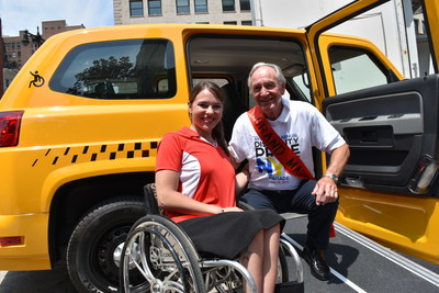 Mobility Ventures, spokesperson Kristina Rhodes, and Former Senator Tom Harkin, architect of the American's with Disability Act (ADA), pose in the spacious entrance of a new MV-1 vehicle - the only American made vehicle specifically engineered from the ground up in support of wheelchair users and people with other disabilities.  The new 2016 MV-1 was unveiled at the  New York City Disability Pride Parade where Mobility Ventures was the lead sponsor.