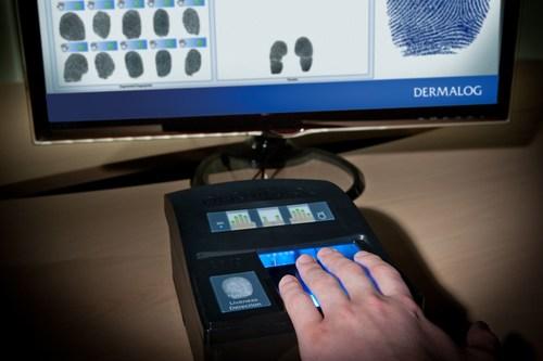 The DERMALOG LF10 fingerprint scanner used for the registration of refugees (PRNewsFoto/Dermalog Identification  ...