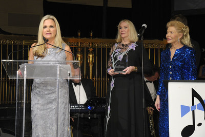 "President & CEO Dr. Robin Ganzert (left) accepts the ""Outstanding Animal Welfare Organization of the Year"" award for American Humane from Pet Philanthropy Circle founding president Jewel Morris (center) at the annual ""Pet Hero Awards"" in New York City. Philanthropist, animal advocate, and American Humane board member Lois Pope is at right."