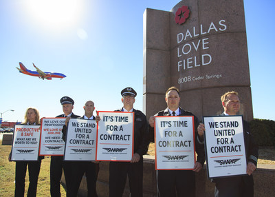 Pilots from the Southwest Airlines Pilots' Association (SWAPA) picket at Dallas Love Field Airport to demonstrate frustration after nearly four years of negotiations without an acceptable contract.