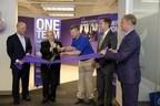 Phil Fernandez, CEO of Marketo, and Sam Massell, president of the Buckhead Coalition and former Mayor of Atlanta, unveil Marketo's new offices in Atlanta. (PRNewsFoto/Marketo Inc.)