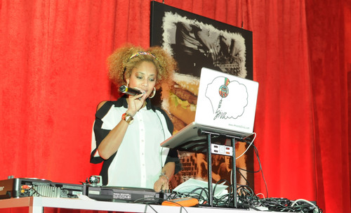 Television correspondent Amanda Seales spins the latest tracks for the McDonald's Flavor Battle launch party in Times Square. McDonald's Flavor Battle is a national online DJ competition that showcases some of America's hottest up-and-coming mix-masters and beatsmiths. Photo Credit: Cali |York Photography.   (PRNewsFoto/McDonald's USA, LLC, Cali |York Photography)
