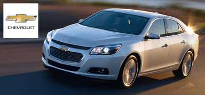 The 2014 Chevy Malibu has been redesigned and rebuilt to take advantage of new fuel-saving technologies and is a perfect summer getaway car. (PRNewsFoto/Chevrolet of Naperville) (PRNewsFoto/Chevrolet of Naperville)