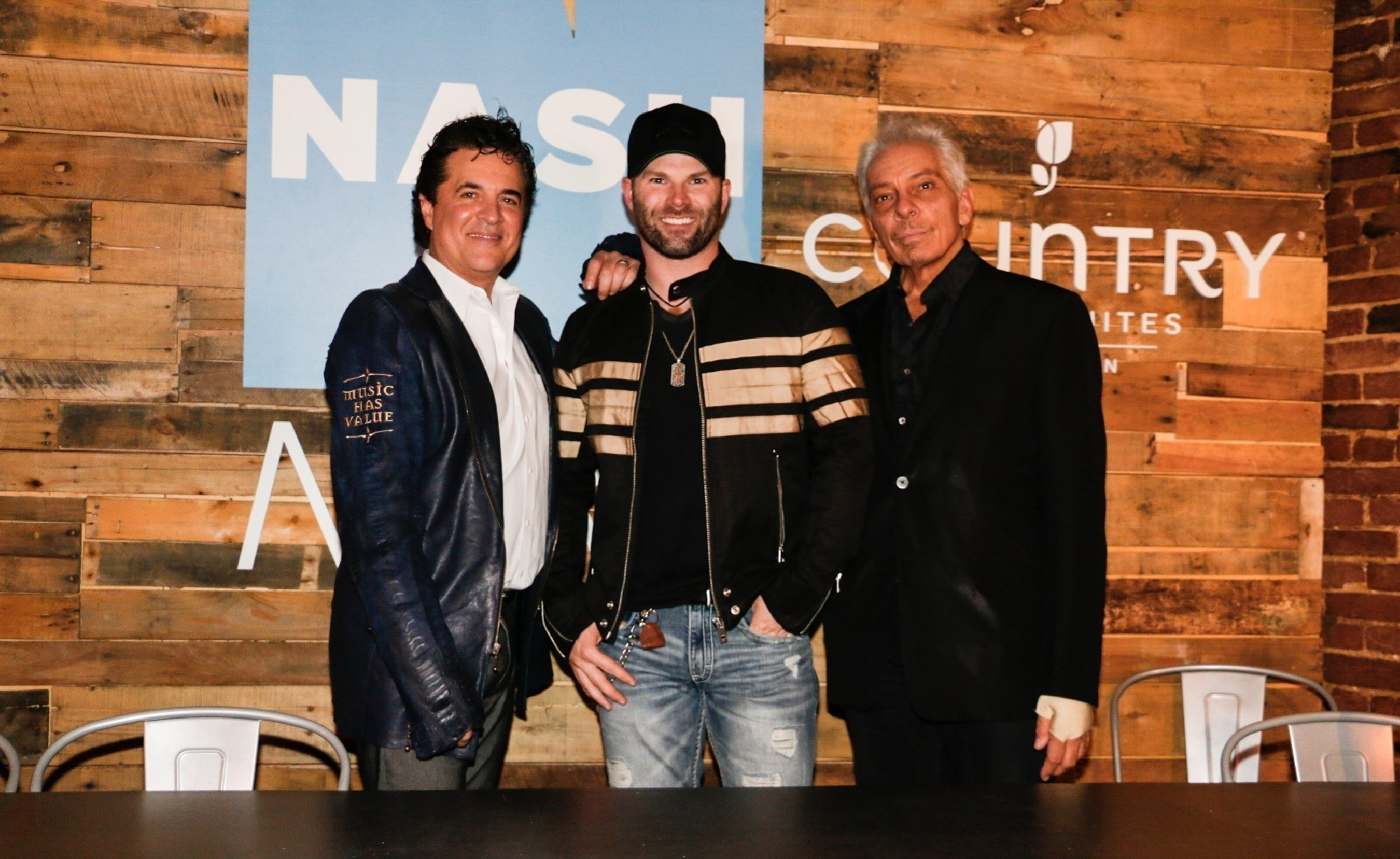Scott Borchetta (L), Founder, President and CEO of Big Machine Label Group, flanks NASH Next 2016 Challenge winner, Country singer Todd O'Neill, with Mike McVay (R), SVP, Content and Programming, Cumulus Media and Westwood One, at Mercy Lounge in Nashville on Tuesday, October 25, 2016.