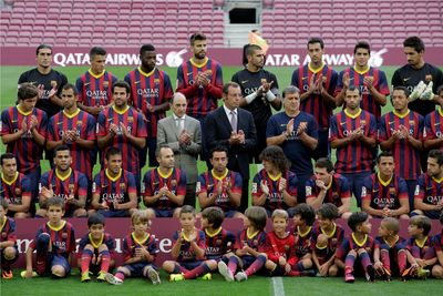 The CEO of Qatar Airways and the President of FC Barcelona, together with first team players and FCBEscola players, at this evening's presentation