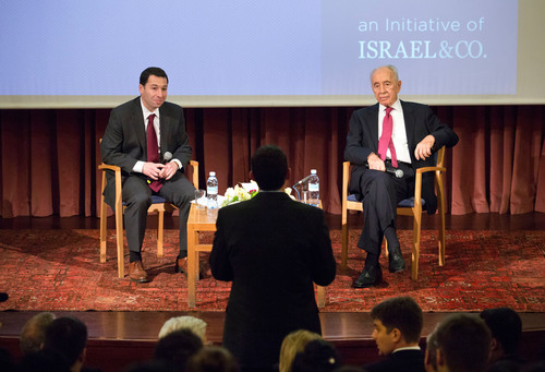 Israeli President Shimon Peres (right), shown with Israel & Co. founder and CEO Rafi Musher, speaks with ...