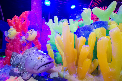 The ICE LAND: Ice Sculptures attraction opened Saturday at Moody Gardens with a new Caribbean Christmas theme with sculptures carved out of 2 million pounds of ice.
