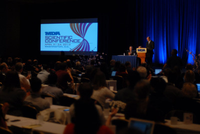 """The progress being made in neuromuscular disease research is truly astonishing,"" said MDA President and CEO Steven M. Derks in opening MDA's 2013 scientific conference Monday morning in Washington. The conference, which runs through April 21-24, has drawn more than 500 research professionals from around the world interested in identifying and overcoming barriers to neuromuscular disease research.  (PRNewsFoto/Muscular Dystrophy Association)"