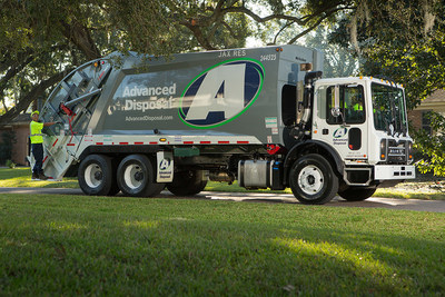 Advanced Disposal rear loading collection truck on a route in a residential neighborhood.