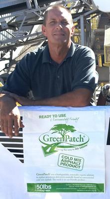 Bret Reinhard, Operations Mgr (Paragon Concrete Products, AZ) dons GreenPatch packaging.  (PRNewsFoto/GreenPatch)