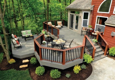 The TimberTech Terrain Decking Collection's Silver Maple color is featured in the photo.