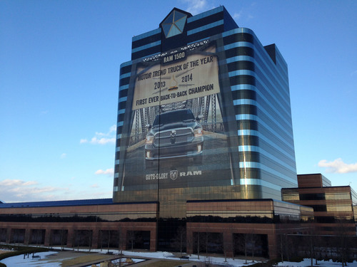 The Ram Truck brand celebrates the Ram 1500 winning its first-ever back-to-back Motor Trend 'Truck of Year(R)' honor with a 145-feet-wide-by-155-feet-tall building wrap on the front of the Chrysler Group LLC headquarters in Auburn Hills, Mich. The Ram 1500 won the Motor Trend award in 2013 and 2014 and is the only vehicle to ever win this prestigious honor for two consecutive years.  (PRNewsFoto/Chrysler Group LLC)