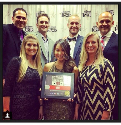 Q1Media team celebrating at awards gala in Austin, Texas.  (PRNewsFoto/Q1Media)
