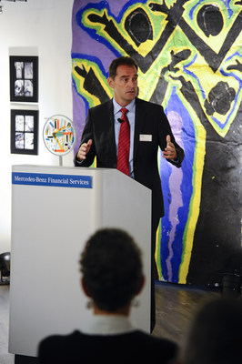 Mercedes-Benz Financial Services President and CEO Peter Zieringer speaks to guests about the partnership with Cranbrook Academy of Arts during the Experiencing Perspectives community art reception held at the company's regional headquarters in Farmington Hills on September 30.