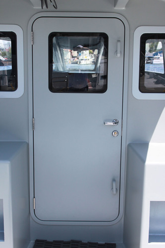 Zyvex Marine and Pacific Coast Marine announce the world's first nano-enhanced lightweight door weighing 66% less than traditional marine doors.  (PRNewsFoto/Zyvex Marine)