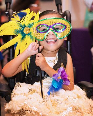 Pediatric patients at St. Joseph's Children's Hospital in Tampa enjoy a masquerade-themed prom held in their honor Friday, April 25, 2014.  (PRNewsFoto/St. Joseph's Children's Hospital)