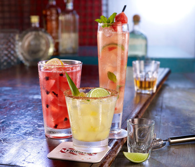 """From the bar that is credited with inventing the now-classic Long Island Iced Tea come four new refreshing cocktails that will surely become legends of their own. Guests at Friday's can sip and savor the flavors of the season with new cocktails - the crisp Fresh Watermelon Mojito, the sweet heat of """"The Tiki Torch"""" - a pineapple chipotle margarita, and the invigorating Strawberry Rum Smash, or they can enjoy the latest innovative version of Friday's famous classic, Fresh Blackberry Long Island Iced Tea.  (PRNewsFoto/T.G.I. Friday's)"""